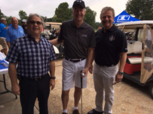 Image of mayor Mike Gaskill, Arkansas Governor Asa Hutchinson and Prosecuting Attorney Scott Ellington at the ASP Foundation Golf tournament fund raiser.