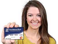 A smiling young woman holds up the FNB debit card.