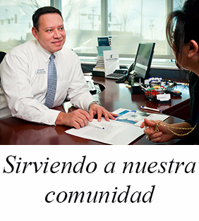 "Rafael is greeting a customer.  The text image caption under the photo image says in the Spanish language:  ""Sirviendo a nuestra comunidad"".  In English this caption means: ""Serving our community"""
